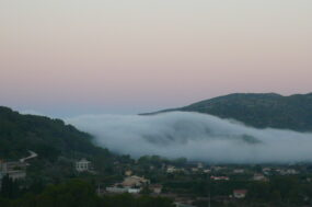 Eerie morning cloud:mist over the village